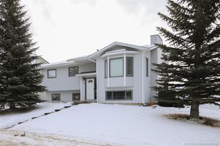 Main Photo: 11 Aspen Drive in Sylvan Lake: SL Lakeview Heights Residential for sale : MLS®# CA0186268