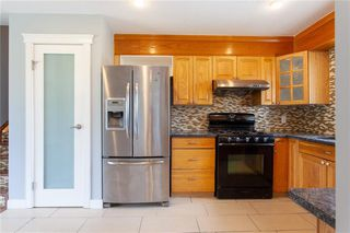 Photo 4: 3216 Rundleside Drive NE in Calgary: Rundle Detached for sale : MLS®# C4303077