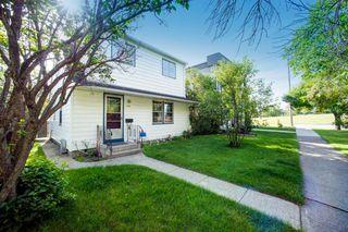 Photo 2: 104 11 Street NE in Calgary: Bridgeland/Riverside Detached for sale : MLS®# A1013693