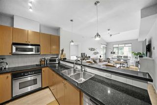 "Photo 12: 415 100 CAPILANO Road in Port Moody: Port Moody Centre Condo for sale in ""SUTERBROOK"" : MLS®# R2501511"