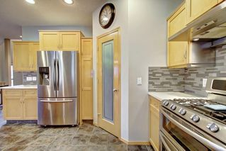 Photo 6: 91 ROCKBLUFF Close NW in Calgary: Rocky Ridge Detached for sale : MLS®# C4267762