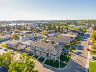 Main Photo: 1104 40 Street SW in Calgary: Rosscarrock Row/Townhouse for sale : MLS®# A1034743