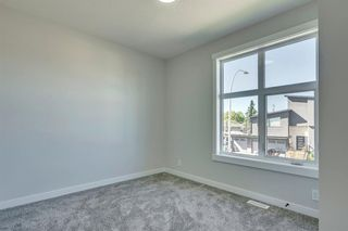 Photo 28: 1104 40 Street SW in Calgary: Rosscarrock Row/Townhouse for sale : MLS®# A1034743