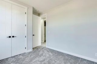 Photo 27: 1104 40 Street SW in Calgary: Rosscarrock Row/Townhouse for sale : MLS®# A1034743