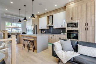 Photo 10: 1104 40 Street SW in Calgary: Rosscarrock Row/Townhouse for sale : MLS®# A1034743