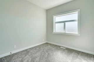 Photo 30: 1104 40 Street SW in Calgary: Rosscarrock Row/Townhouse for sale : MLS®# A1034743