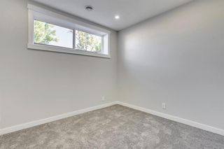 Photo 34: 1104 40 Street SW in Calgary: Rosscarrock Row/Townhouse for sale : MLS®# A1034743