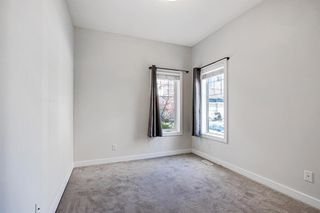 Photo 17: 1501 281 Cougar Ridge Drive SW in Calgary: Cougar Ridge Row/Townhouse for sale : MLS®# A1040162
