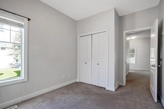 Photo 18: 1501 281 Cougar Ridge Drive SW in Calgary: Cougar Ridge Row/Townhouse for sale : MLS®# A1040162