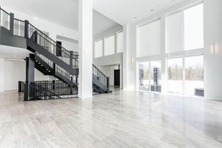 Photo 5: 980 101 Street SW in Calgary: West Springs Detached for sale : MLS®# A1058103