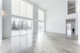 Photo 4: 980 101 Street SW in Calgary: West Springs Detached for sale : MLS®# A1058103