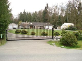 Photo 1: 26598 64TH Avenue in Langley: County Line Glen Valley House for sale : MLS®# F2901181