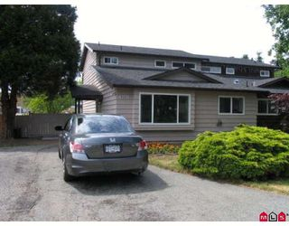 Photo 1: 9061 135A Street in Surrey: Queen Mary Park Surrey House 1/2 Duplex for sale : MLS®# F2912646