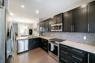 Photo 8: 7708 181 Avenue in Edmonton: Zone 28 House for sale : MLS®# E4180848
