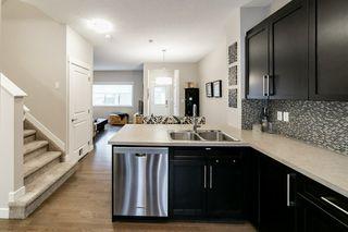 Photo 10: 7708 181 Avenue in Edmonton: Zone 28 House for sale : MLS®# E4180848
