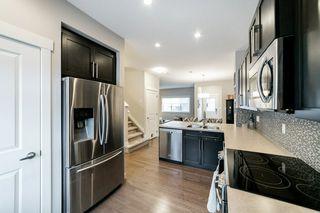 Photo 9: 7708 181 Avenue in Edmonton: Zone 28 House for sale : MLS®# E4180848
