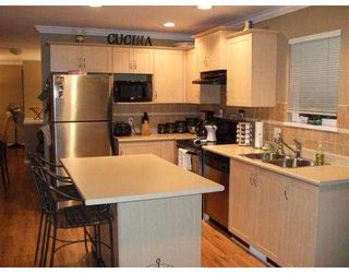 """Photo 5: 329 3000 RIVERBEND Drive in Coquitlam: Coquitlam East House for sale in """"RIVERBEND"""" : MLS®# V725118"""