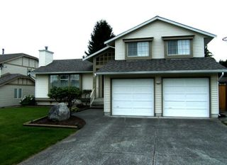 "Photo 1: 6472 130A Street in Surrey: West Newton House for sale in ""DEER PARK"" : MLS®# F2827525"