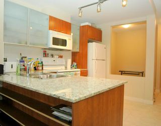 """Photo 4: 324 4078 KNIGHT Street in Vancouver: Knight Condo for sale in """"KING EDWARD VILLAGE"""" (Vancouver East)  : MLS®# V761467"""