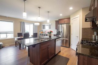 Photo 2: 1251 STARLING Drive in Edmonton: Zone 59 House Half Duplex for sale : MLS®# E4174556