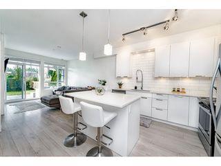 """Photo 2: 111 22562 121 Avenue in Maple Ridge: East Central Condo for sale in """"EDGE 2"""" : MLS®# R2411283"""