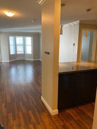 "Photo 2: 309 5454 198 Street in Langley: Langley City Condo for sale in ""Brydon Walk"" : MLS®# R2517322"