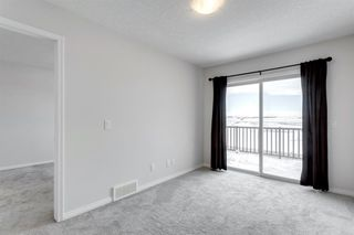 Photo 25: 4148 Windsong Boulevard SW: Airdrie Row/Townhouse for sale : MLS®# A1059937