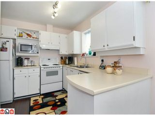 "Photo 2: 1 6537 138TH Street in Surrey: East Newton Townhouse for sale in ""CHARLESTON GREEN"" : MLS®# F1006130"