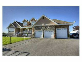Photo 1: 13489 NEAVES Road in Pitt Meadows: North Meadows PI House for sale : MLS®# V861430