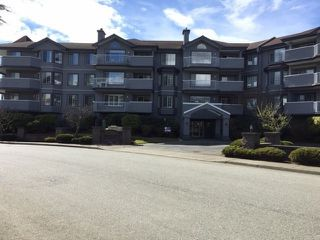 "Photo 1: 203 5375 205 Street in Langley: Langley City Condo for sale in ""GLENMONT PARK"" : MLS®# R2455636"