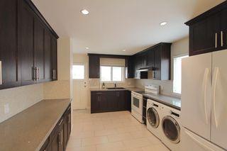 Photo 2: 5939 BATTISON Street in Vancouver: Killarney VE House for sale (Vancouver East)  : MLS®# R2389460