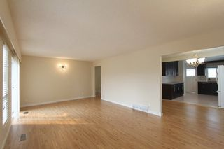 Photo 7: 5939 BATTISON Street in Vancouver: Killarney VE House for sale (Vancouver East)  : MLS®# R2389460