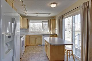 Photo 12: 641 ADVENT Bay in Rural Rocky View County: Rural Rocky View MD Semi Detached for sale : MLS®# C4301047