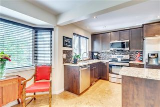 Photo 12: 114 Glamis Terrace SW in Calgary: Glamorgan Row/Townhouse for sale : MLS®# C4305468