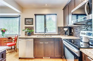 Photo 10: 114 Glamis Terrace SW in Calgary: Glamorgan Row/Townhouse for sale : MLS®# C4305468