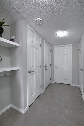 Photo 5: 156 WINDFORD Gardens SW: Airdrie Row/Townhouse for sale : MLS®# A1031848