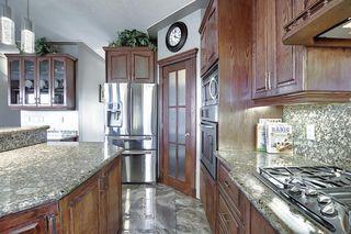 Photo 6: 50 Hidden Ranch Boulevard NW in Calgary: Hidden Valley Detached for sale : MLS®# A1047627