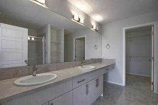 Photo 18: 212 LUCAS Manor NW in Calgary: Livingston Detached for sale : MLS®# C4288986
