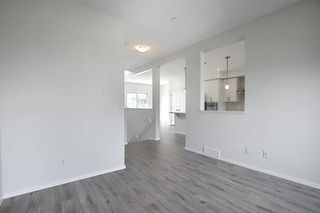 Photo 11: 212 LUCAS Manor NW in Calgary: Livingston Detached for sale : MLS®# C4288986