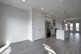 Photo 9: 212 LUCAS Manor NW in Calgary: Livingston Detached for sale : MLS®# C4288986