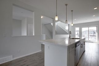 Photo 2: 212 LUCAS Manor NW in Calgary: Livingston Detached for sale : MLS®# C4288986