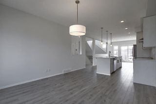 Photo 8: 212 LUCAS Manor NW in Calgary: Livingston Detached for sale : MLS®# C4288986