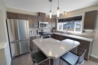 Photo 1: 6917 21A Avenue in Edmonton: Zone 53 House Half Duplex for sale : MLS®# E4197901