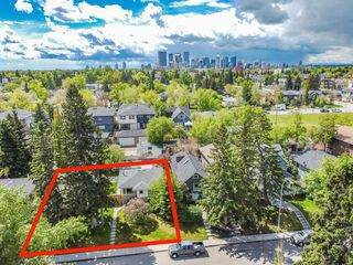 Photo 4: 235 25 Avenue NE in Calgary: Tuxedo Park Detached for sale : MLS®# A1040090