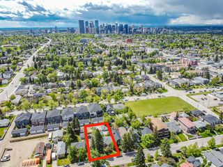 Photo 8: 235 25 Avenue NE in Calgary: Tuxedo Park Detached for sale : MLS®# A1040090