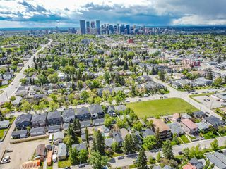 Photo 6: 235 25 Avenue NE in Calgary: Tuxedo Park Detached for sale : MLS®# A1040090