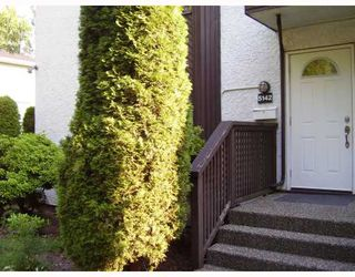 "Photo 1: 5142 HASTINGS Street in Burnaby: Capitol Hill BN Townhouse for sale in ""MAYWOOD"" (Burnaby North)  : MLS®# V784480"