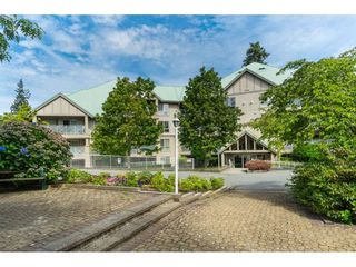 "Photo 1: 412 15150 29A Avenue in Surrey: King George Corridor Condo for sale in ""Sands II"" (South Surrey White Rock)  : MLS®# R2396902"