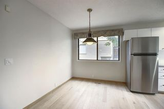 Photo 6: 232 EDGEMONT ESTATES Drive NW in Calgary: Edgemont Row/Townhouse for sale : MLS®# A1033996