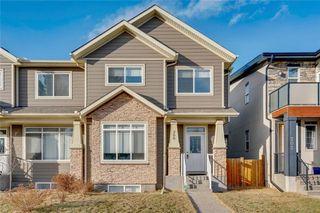 Photo 1: 206 20 Avenue NW in Calgary: Tuxedo Park Semi Detached for sale : MLS®# C4289673